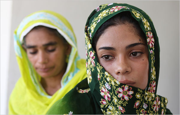 Assiya Rafiq, right, in front of her mother, Iqbal Mai. [Kristof/NYTimes]